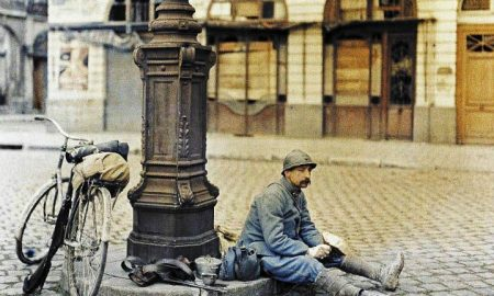 French Solider Taking His Lunch Break in Front of Damaged Library