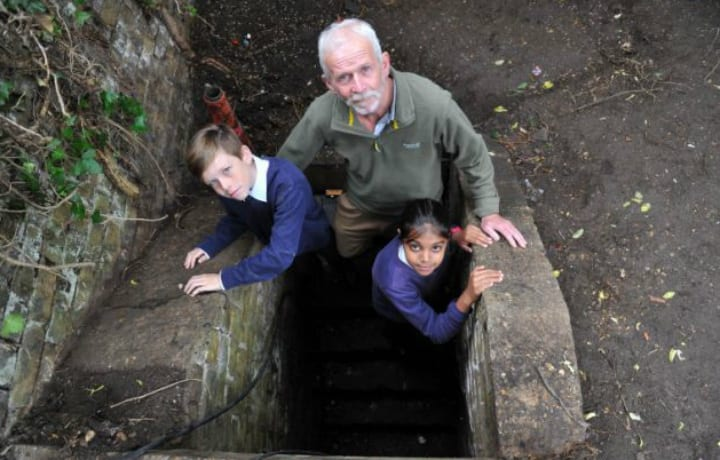School Caretaker Chris Poulter and Students in Anderson Shelter