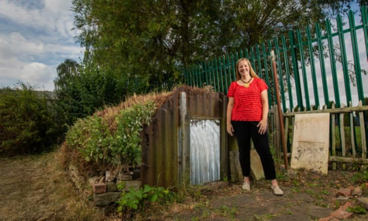 Liz Johnson Next To Her Anderson Shelter