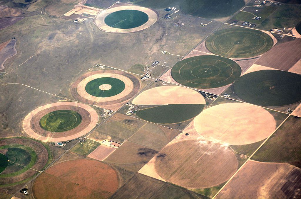 Circles of crops are seen from the air outside Denver, Colorado. The circle patterns are caused by center pivot irrigation systems