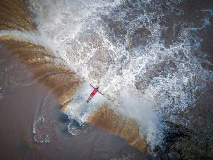 drone photo - waterfall diver