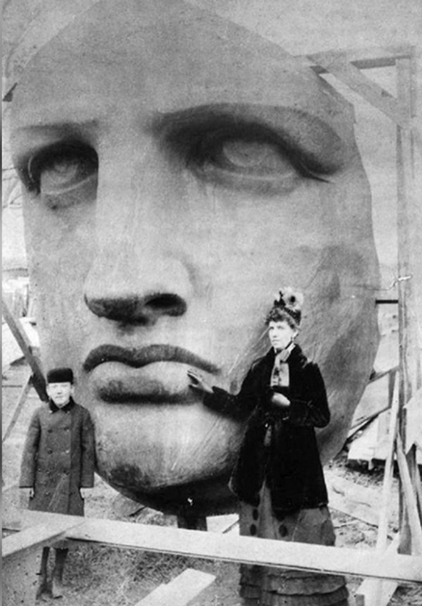 Woman Poses with Statue Of Liberty