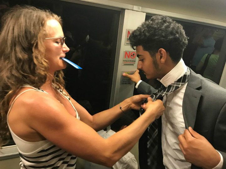 Woman Helps Man With Tie