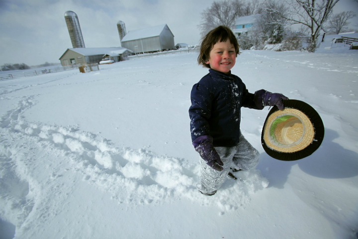 Amish child in snow