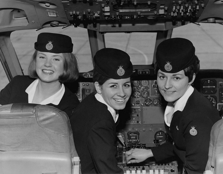 vintage travel - flight attendants in cockpit