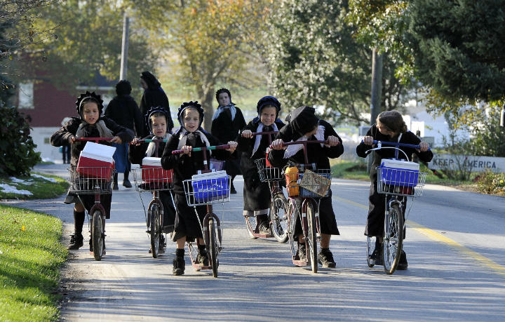 Amish kids on bikes