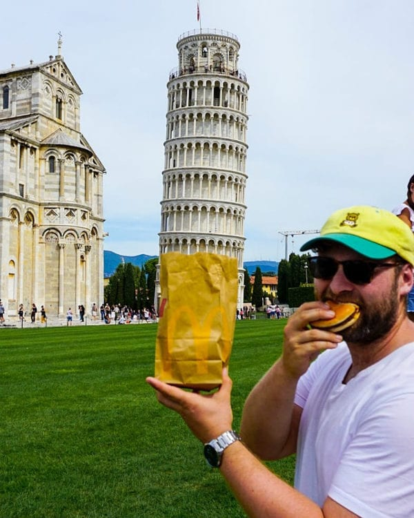 eating in public leaning tower of Pisa