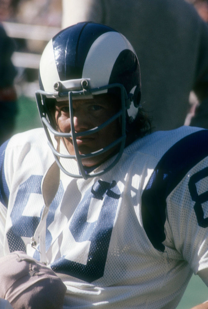 CIRCA 1972: Defensive end Fred Dryer #89 of the Los Angeles Rams sitting on the bench watching the action during an NFL football game circa 1972. Dryer played for the Rams from 1972-81.