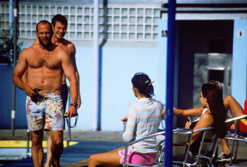 ***EXCLUSIVE ALL-ROUND*** LONDON - July 21, 2003 - Actor Jason Statham and Lock Stock & Two Smoking Barrels co-star Jason Flemyng prepare to take a swim at the Tooting Bec Lido outdoor swimming pool while girlfriend, actress Kelly Brook, looks on with friends.