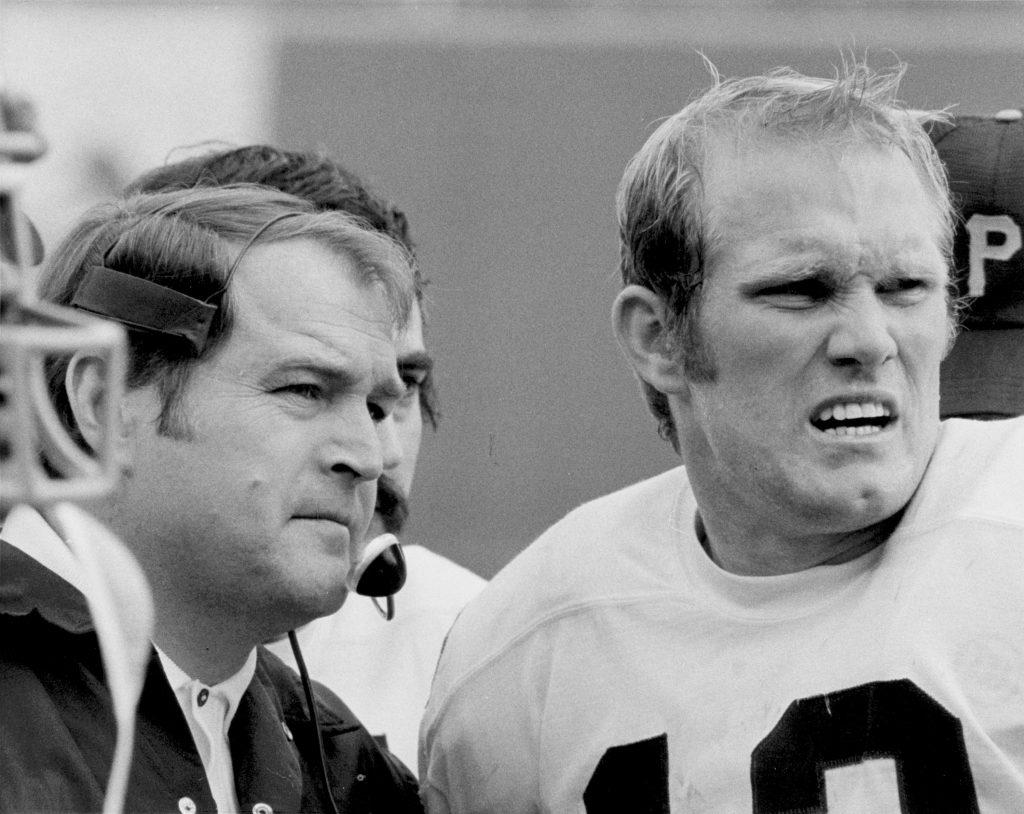 Pittsburgh Steelers head coach Chuck Noll confers with quarterback Terry Bradshaw (12) during a 24-2 victory over the San Diego Chargers on December 17, 1972, at San Diego Stadium in San Diego, California.