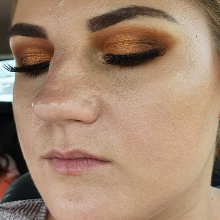 Woman in thick powdery makeup