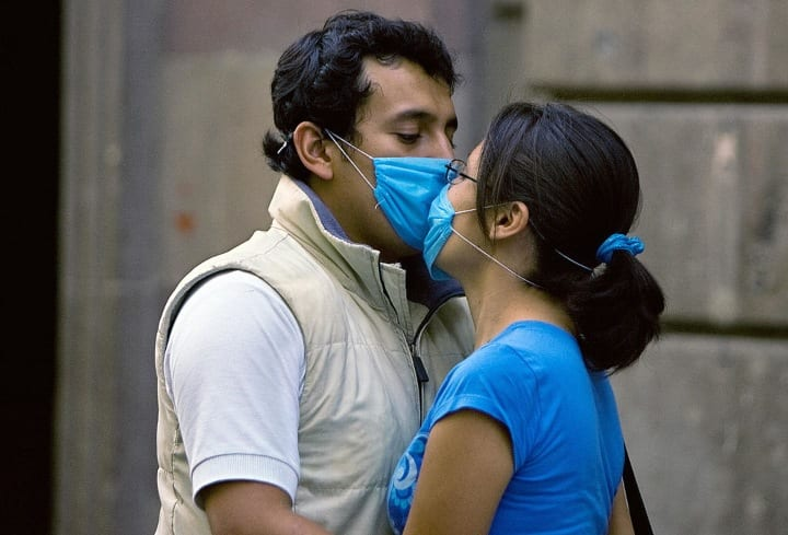 Swine Flu couple kissing with masks