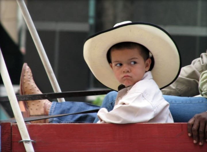 Little boy in Texas ten gallon hat