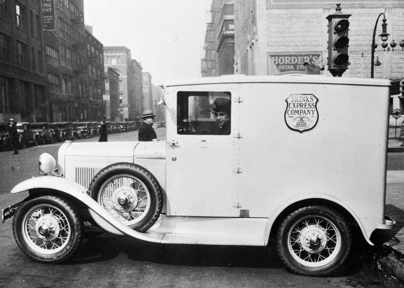 Delivery man in FedEx car circa 1930 everyday items