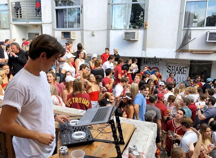DJ at fraternity party