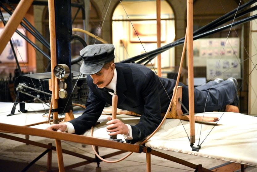 model of Orville Wright and early airplane