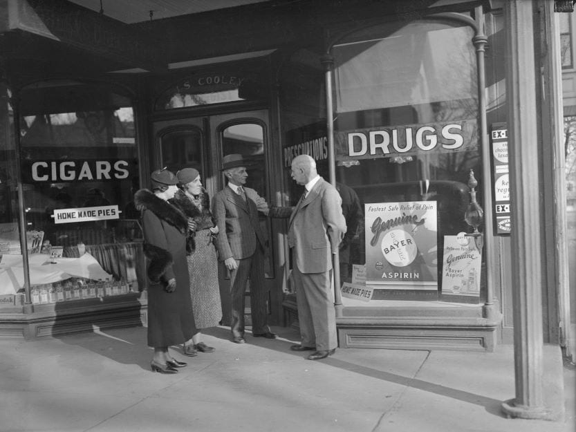 Group of people outside pharmacy